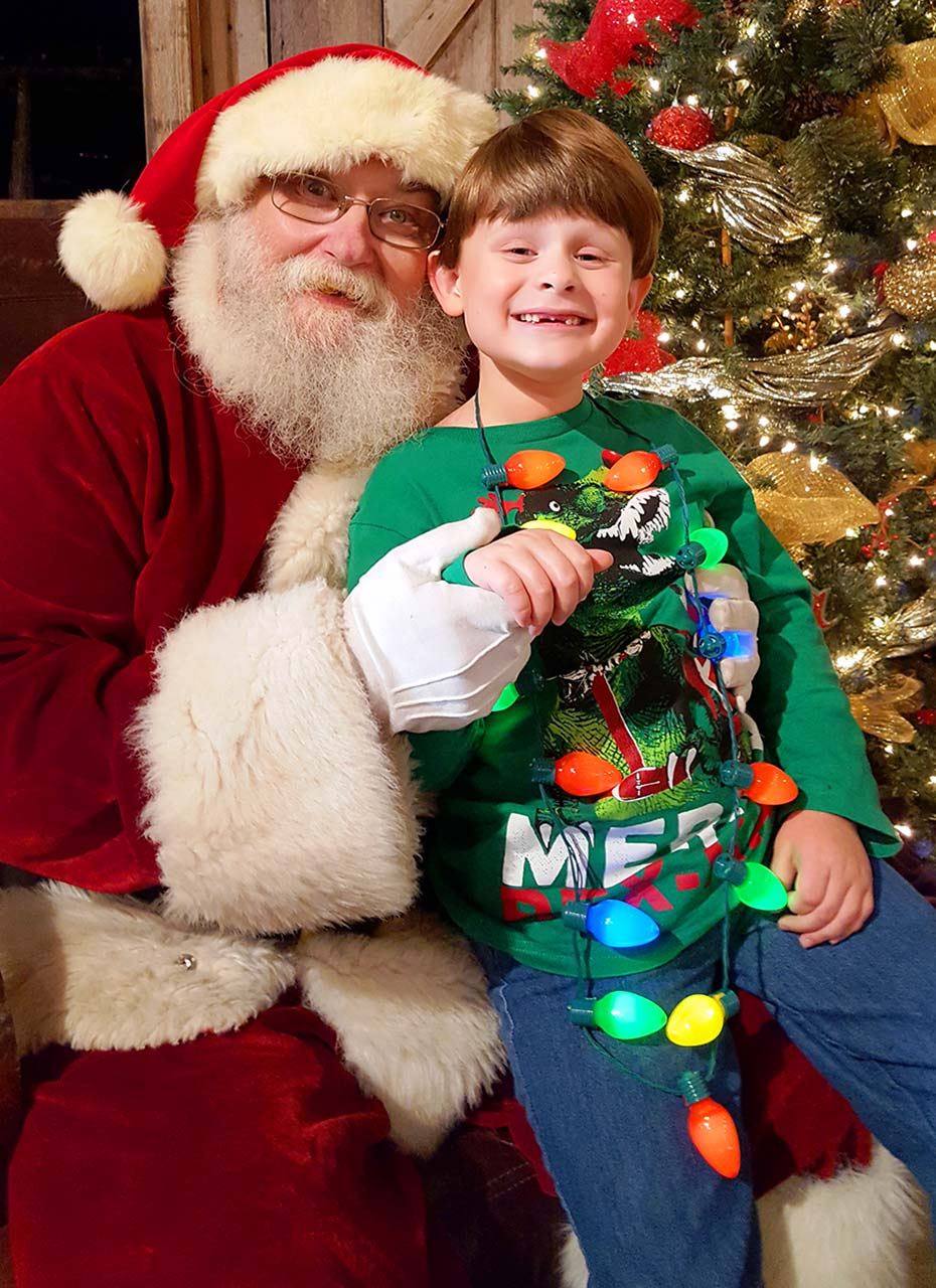 A Smiling With Santa And Lights Web